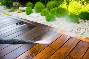 Power washer cleaning deck