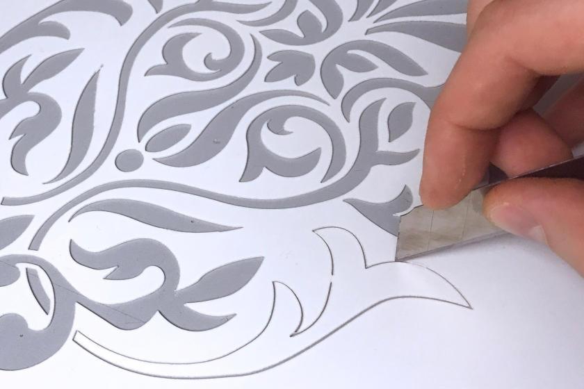 Cutting custom stencil with knife blade