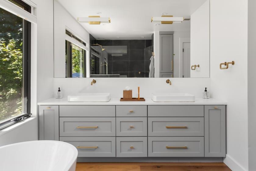 New gold handles on gray bathroom vanity
