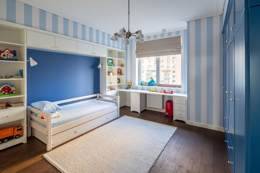 Kid's bedroom with blue and white stripes
