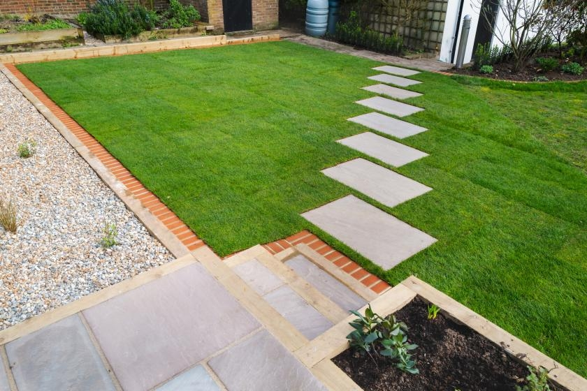 Stepping stone walkway in backyard
