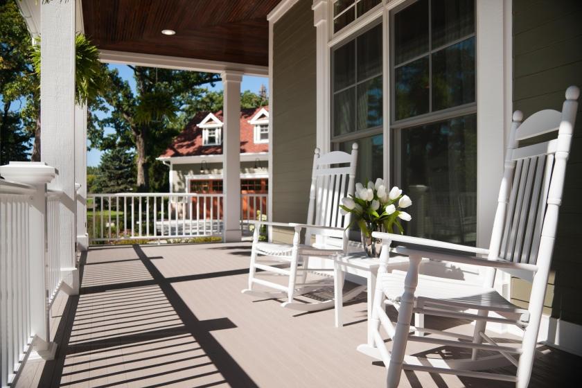 Large wraparound porch with crisp paint