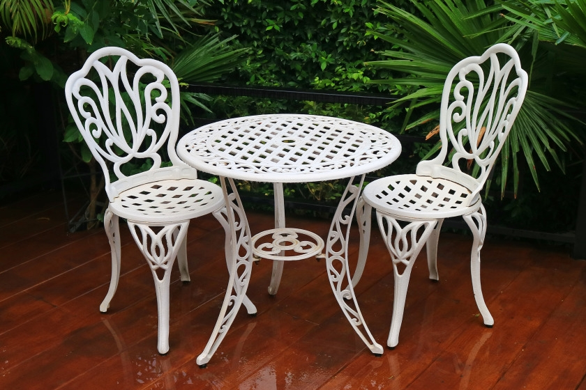 White, wrought iron furniture on patio